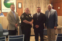 Plainview Police Lieutenant William Bridgwater is recognized Tuesday evening for his recent completion of the Leadership Command College - Class 84 of the Law Enforcement Management Institute of Texas. (L-R) City Manager Jeffrey Snyder, Police Chief Ken Coughlin, Lt. Bridgwater and Mayor Wendell Dunlap.