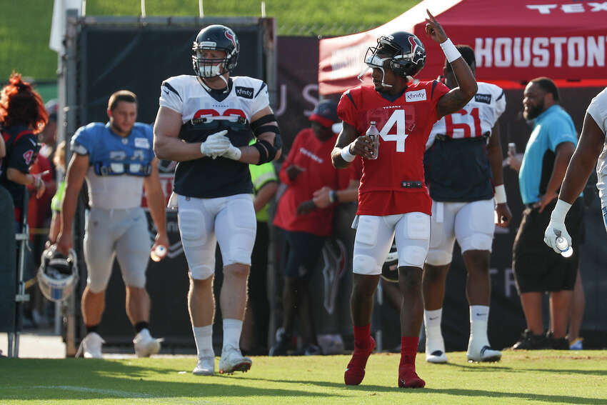 Houston Texans defensive end J.J. Watt (99) and quarterback Deshaun Watson (4) walk onto the field for a joint training camp practice with the Detroit Lions at the Houston Methodist Training Center on Thursday, Aug. 15, 2019, in Houston.