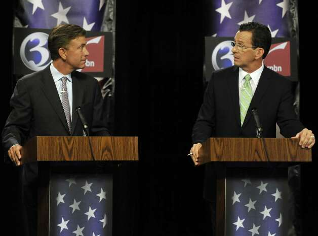 Democratic candidates for governor Ned Lamont, left, and Dan Malloy look at each other as Malloy answers a question during a debate in Rocky Hill, Conn., Tuesday, Aug. 3, 2010. (AP Photo/Jessica Hill) Photo: Jessica Hill, AP / Associated Press