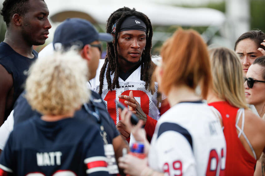 Houston Texans wide receiver DeAndre Hopkins signs autographs following a joint training camp practice with the Detroit Lions at the Houston Methodist Training Center on Thursday, Aug. 15, 2019, in Houston.