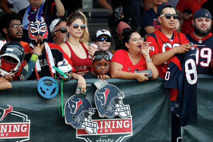 Houston Texans fans wait for players to sign autographs during a joint training camp practice with the Detroit Lions at the Houston Methodist Training Center on Thursday, Aug. 15, 2019, in Houston.