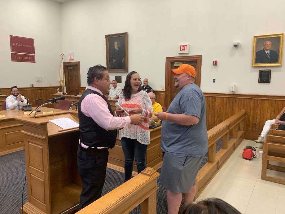 Ansonia Mayor David Cassetti presents separate keys to the city to Jeremy Mushnicki and Dawn Ossie for creating Orange You For Ansonia which provides free activities to children. Photo: / Michael P. Mayko