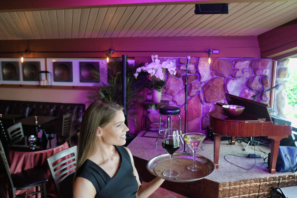 Janine Markham, a cocktail waitress at Panza's is seen in the lounge area of the restaurant on Tuesday, Aug. 6, 2019, in Saratoga Springs, N.Y. (Paul Buckowski/Times Union)
