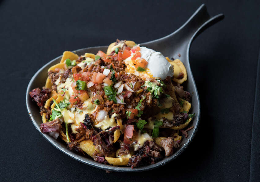Killen's Barbecue Frito Pie (Sections 109, 129) Killen's Frito Pie - Killen's smoked brisket served on Fritos topped with cheddar cheese - is shown during the What's New at NRG Stadium event on Thursday, Aug. 15, 2019 in Houston .