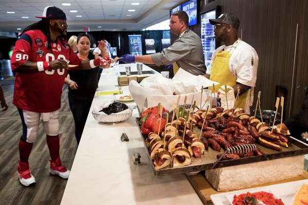 "Houston Texans fan Herman ""Ol Skool"" Eagleton samples the food options during the What's New at NRG Stadium event on Thursday, Aug. 15, 2019 in Houston ."