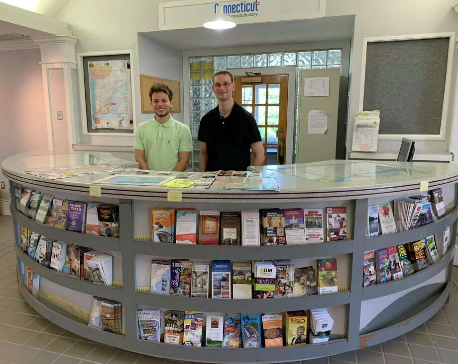 Kevin Reyes, left, and Adam Nizich staff the Tourist Information Center, which reopened Aug. 1 in the state Welcome Center off Exit 2 of I-84 eastbound. Photo: Jacqueline Smith / Hearst Connecticut Media