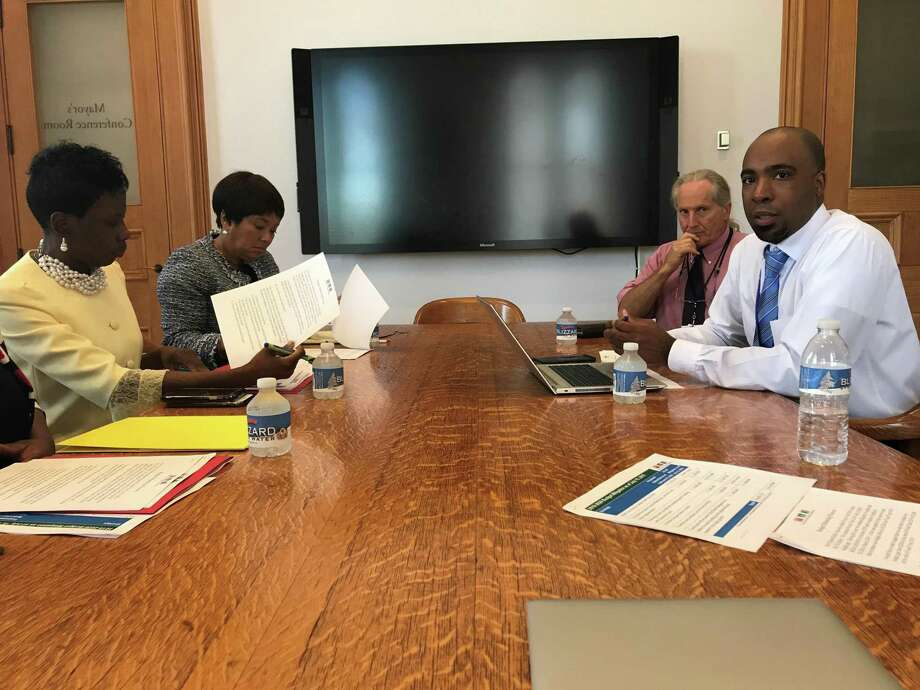 From left, Superintendent of Schools Carol Birks, Mayor Toni Harp, city spokesman Laurence Grotheer and Acting Budget Director Michael Gormany at an Aug. 15, 2019, press briefing in New Haven City Hall. Photo: Brian Zahn / Hearst Connecticut Media