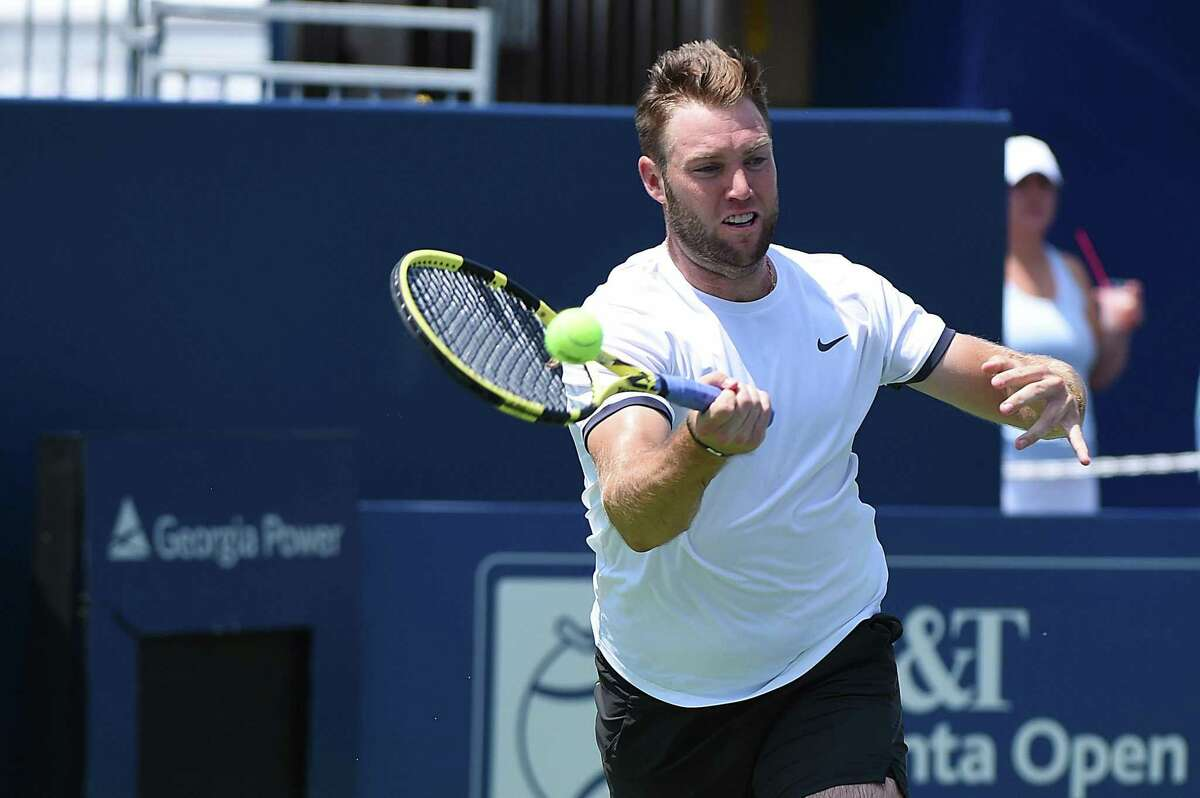 ATLANTA, GEORGIA - JULY 27: Jack Sock returns a forehand to Austin Krajicek and Dominic Inglot of Great Britain during the BB&T Atlanta Open at Atlantic Station on July 27, 2019 in Atlanta, Georgia. (Photo by Logan Riely/Getty Images)