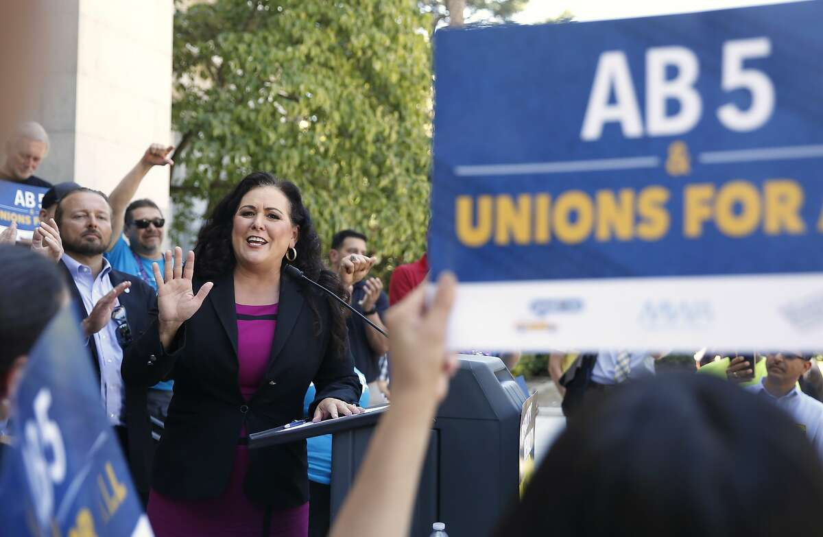 Assemblywoman Lorena Gonzalez, D-San Diego, speaks at a rally after her measure to limit when companies can label workers as independent contractors was approved by a Senate committee, in Sacramento, Calif., Wednesday, July 10, 2019. The measure, AB5, is aimed at major employers like Uber and Lyft. The bill still needs approval by the full Senate. (AP Photo/Rich Pedroncelli)
