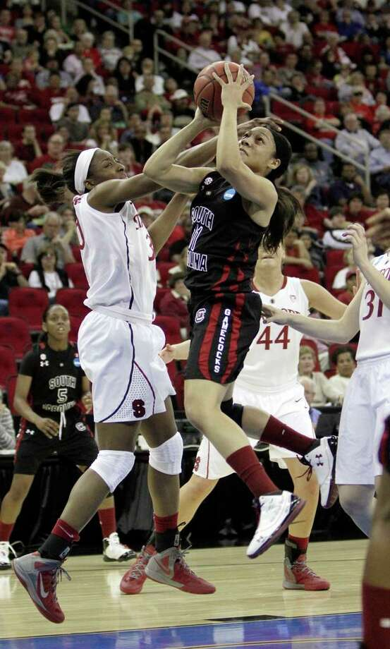 South Carolina guard La'Keisha Sutton, right, drives to the basket against Stanford's Nnemkadi Ogwumike during the first half of an NCAA women's tournament regional semifinal college basketball game in 2012 in Fresno, California. Sutton will be coming to Middletown Friday and Saturday for Ball Like A Girl. Photo: Rich Pedroncelli / Associated Press / AP