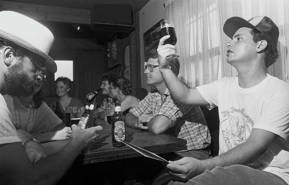 06/11/1983 -Participants in the First Annual Foam Rangers Pub Crawl enjoy their brews.