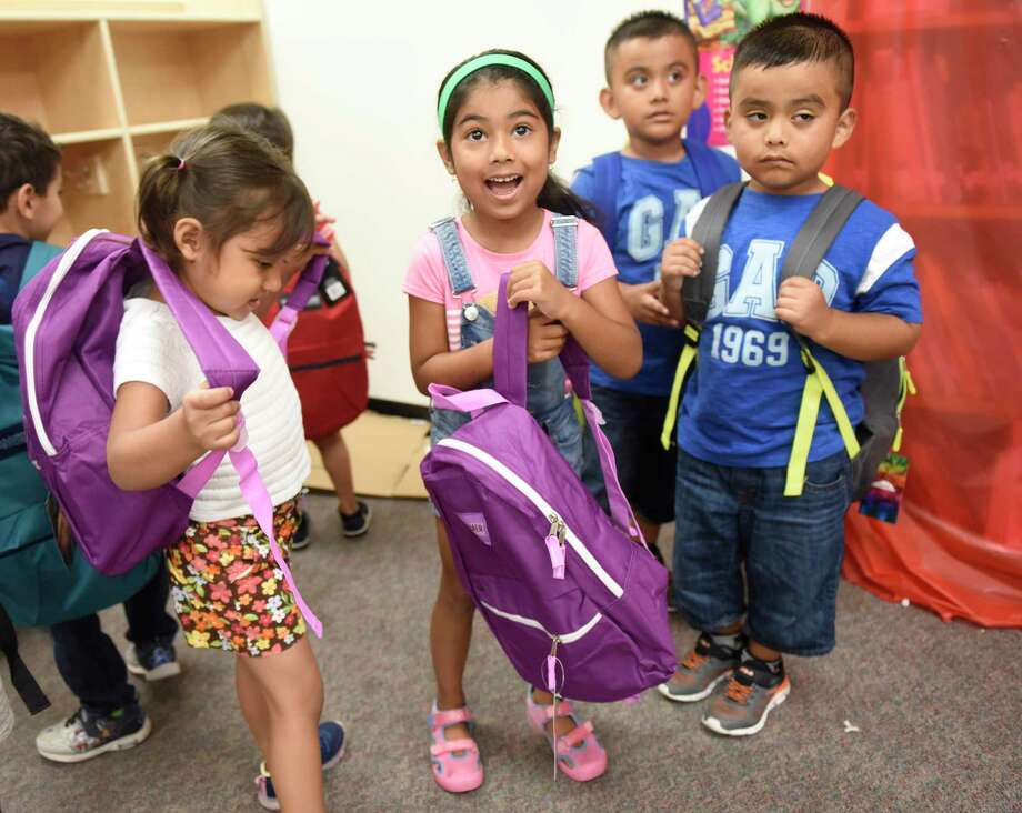 Jennalyn Gramajo, left, Elizabeth Borrayes, and brothers Steve and Jefferson Najera try our the new backpacks they were given at the backpack distribution for incoming Stamford kindergarteners at Hart Magnet Elementary School in Stamford, Conn. Thursday, Aug. 15, 2019. Stamford-area Allstate agency owners and the Stamford Public Education Foundation (SPEF) teamed up to distribute about 100 backpacks with school supplies to attendees of SPEF's Summer Start program, helping prepare them to start kindergarten at the end of August. In addition to the backpacks, Allstate presented a $5,000 donation to SPEF. Photo: Tyler Sizemore / Hearst Connecticut Media / Greenwich Time