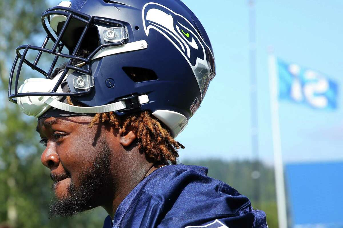 Defensive tackle Jarran Reed steps onto the field during the Seahawks training camp, Thursday, Aug. 15, 2019.