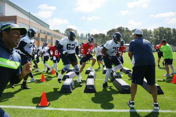 Players run drills during the Seahawks training camp, Thursday, Aug. 15, 2019.