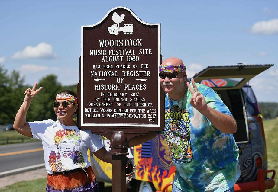 Maria Alger of Brazil and Bob Alger of the U.S. arrive at the Bethel Woods Center for the Arts, the original site of the Woodstock Festival on its 50th anniversary in Woodstock, N.Y. Photo: ANGELA WEISS;Angela Weiss / AFP / Getty Images