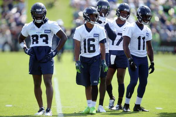 Seahawks wide receivers stand together during the Seahawks training camp, Thursday, Aug. 15, 2019.