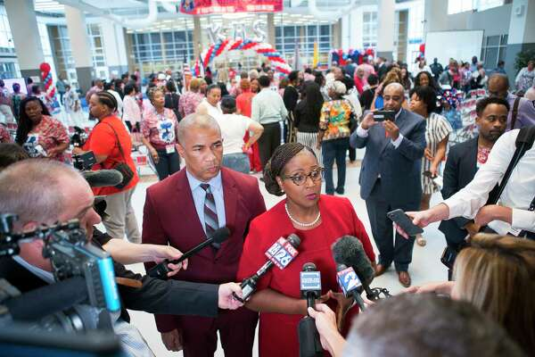 Houston Independent School District Interim Superintendent Dr. Grenita Lathan and Kashmere High School principal Reginald Bush speak with the media following a celebration marking the school's meeting of state expectations for the first time in 11 years at the school in Houston, Thursday, Aug. 15, 2019. Thursday the TEA released the state's latest school accountability ratings.