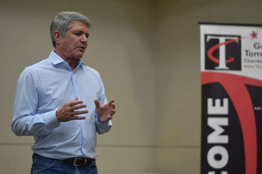Congressman Michael McCaul speaks to a crowd during the a town hall hosted by the Greater Tomball Area Chamber of Commerce on Aug. 13. Photo: Chevall Pryce