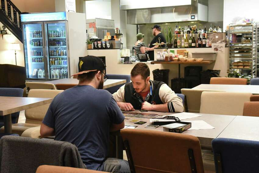 Ray Miller of Watervliet, left, and Josh Framen of Troy, play a game of Boss Monster at Bard and Baker on Thursday, Dec. 6, 2018 in Troy, N.Y. (Lori Van Buren/Times Union)