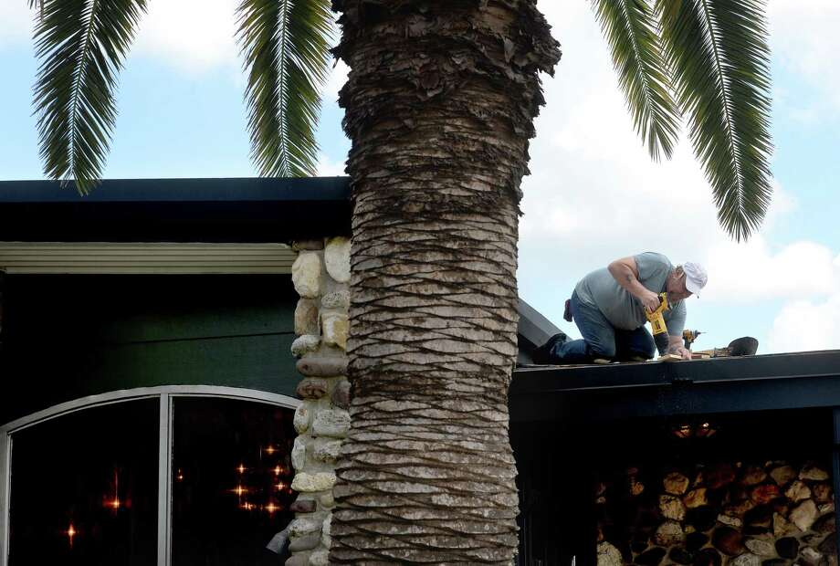 Charles Meaux works on repairs to the overhang at the entry to the banquet hall at Benton's, formerly the Pompano Club, in Port Neches.  The exterior work is the final step in repairs post-Harvey after the establishment received an EDC grant from the city.