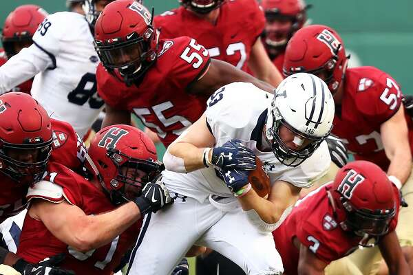 BOSTON, MA - NOVEMBER 17: Zane Dudek #33 of the Yale Bulldog is tackled during a game against the Harvard Crimson at Fenway Park on November 17, 2018 in Boston, Massachusetts. (Photo by Adam Glanzman/Getty Images)