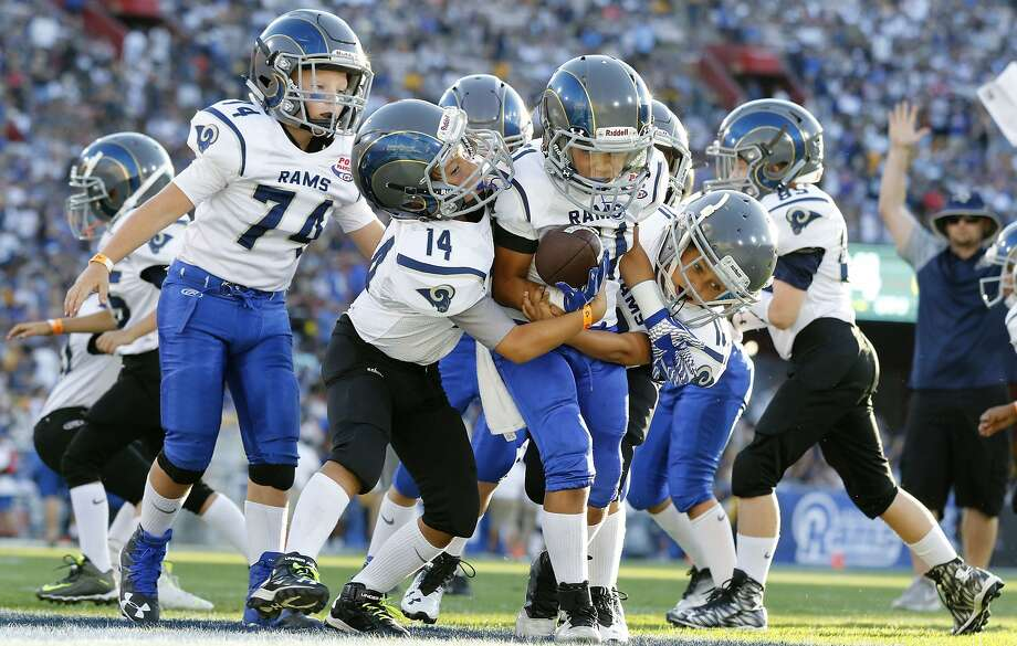 Participation in tackle football is down among children ages 6 to 12 this decade, prompting USA Football to try to develop a program that focuses on skills and cuts down on full-speed contact. Photo: Ryan Kang / Associated Press