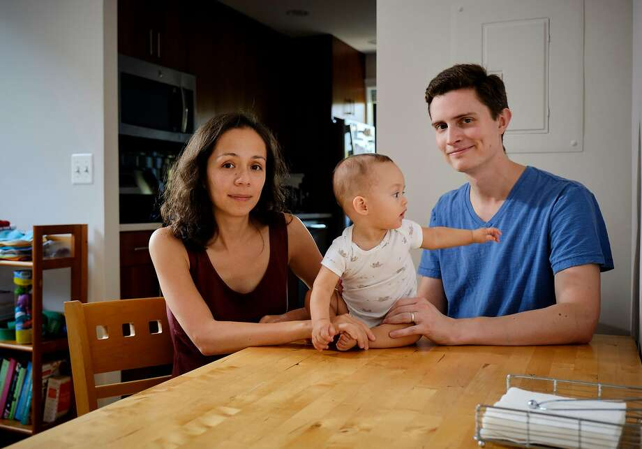 Julia Sheketoff and Mark Savignac, shown with son Henry, are suing Jones Day over its parental leave and wage practices. Photo: T.J. Kirkpatrick / New York Times