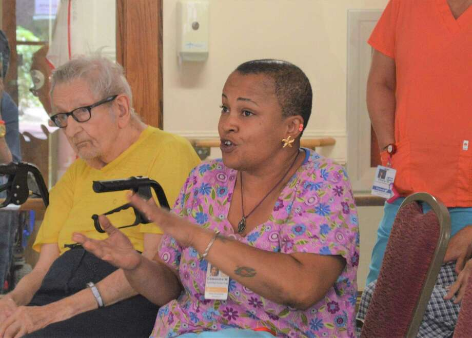 Arden House CNA Cassandra Williams, right, asks town and state officials to fight for keeping the nursing home open. Photo: Clare Dignan / Hearst Connecticut Media