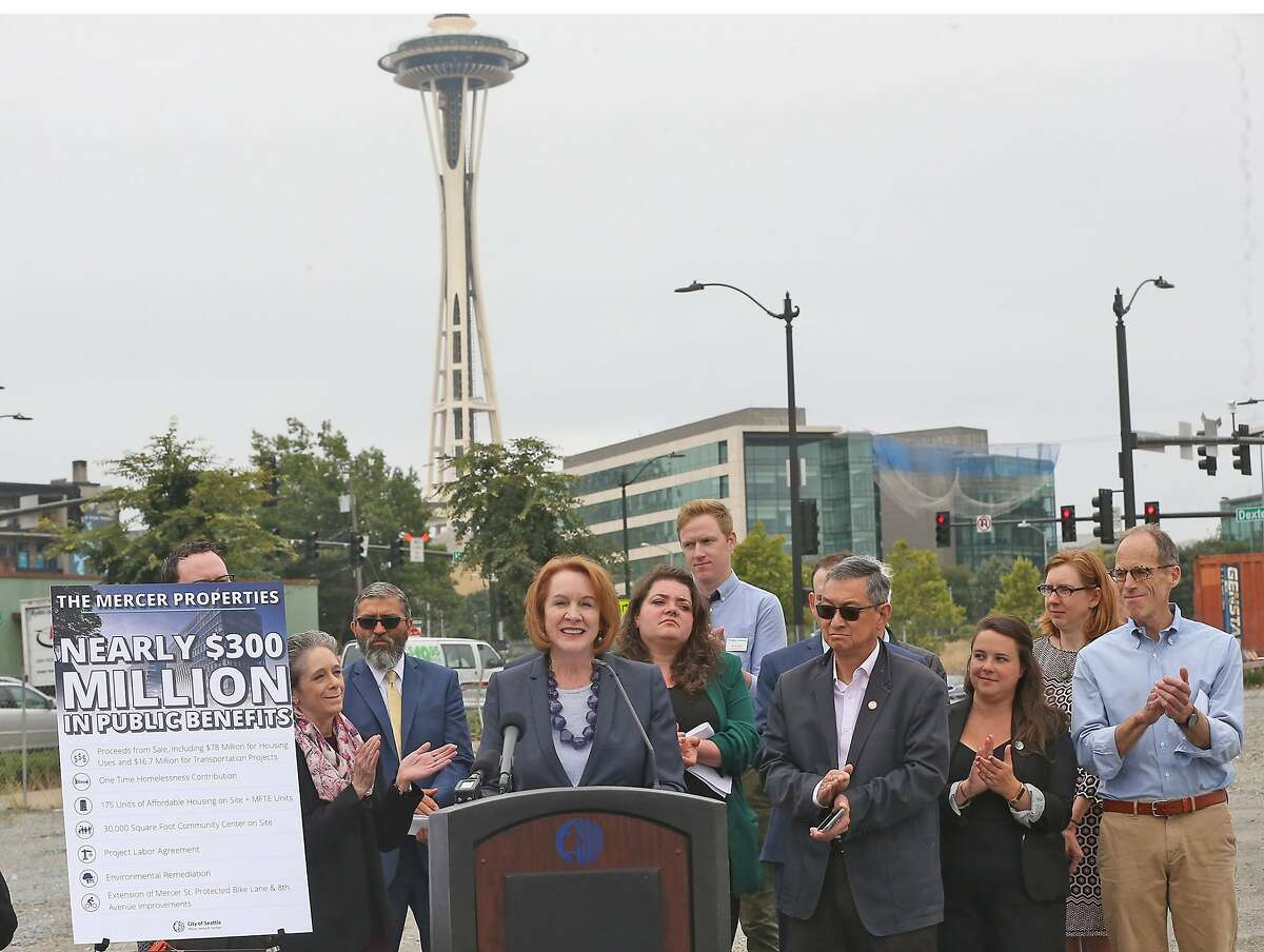 Standing at the site of development, Mercer Street and Dexter Avenue North, Seattle mayor Jenny Durkan announces the city is in negotiations to sell several parcels of land. A development proposed for the site would include 175 units of affordable housing in a community near Amazon's headquarters.