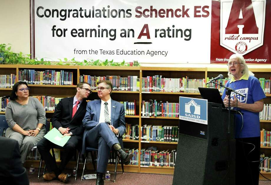 Debra Guerrero is at left, Mike Morath, Texas Commissioner of Education for the Texas Education Agency, chats with Lt. Gov. Dan Patrick, as Patti Radle, right, SAISD Trustee speaks during the announcemet that an A rating for Schenck Elementary School was awarded to the school on Aug. 15. After contemplation and teacher survey feedback, the board has voted to end teacher contracts. Photo: Bob Owen /Staff Photographer / ©2019 San Antonio Express-News