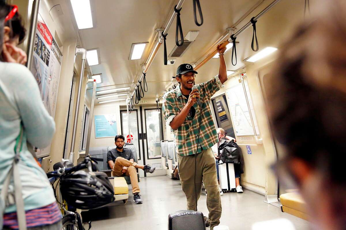 Tone Oliver performs on a BART train for passengers on Wednesday, August 14, 2019 in Oakland, Calif.