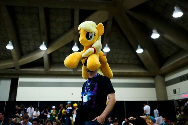 """A man waits in line for the opening ceremony during the BronyCon convention, a gathering for """"My Little Pony"""" fans, at the Baltimore Convention centre in Baltimore, Maryland on Aug. 1, 2019."""