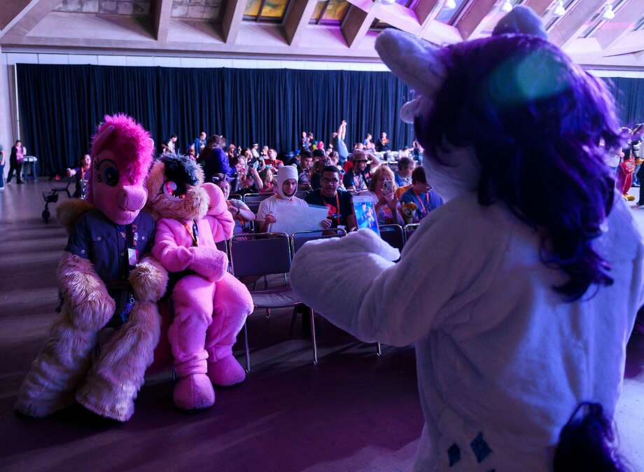 """Fans dressed as """"My Little Pony"""" characters take a photo during the BronyCon convention, a gathering for """"My Little Pony"""" fans, at the Baltimore Convention Centerin Baltimore, Maryland on Aug. 1, 2019. Photo: ANDREW CABALLERO-REYNOLDS/AFP/Getty Images"""