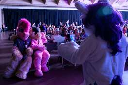 "Fans dressed as ""My Little Pony"" characters take a photo during the BronyCon convention, a gathering for ""My Little Pony"" fans, at the Baltimore Convention centre in Baltimore, Maryland on Aug. 1, 2019."