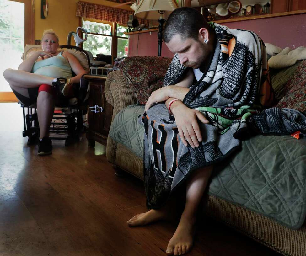In this Monday, July 29, 2019 photo, Dylan Nelson, of Burlington, Wis., and his sister, Andrea, sit for an interview. He was rushed to the hospital in June by his sister last month with severe breathing problems. Doctors believe he and about two dozen other young adults suffered serious lung injuries after vaping nicotine or THC, or both. (Rick Wood/Milwaukee Journal Sentinel via AP)