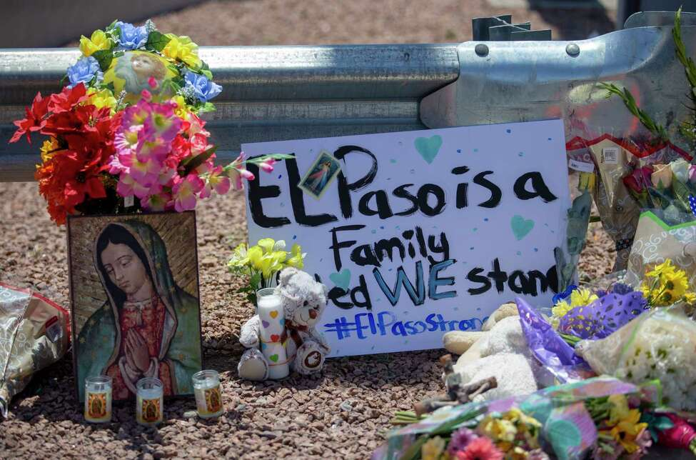 FILE - In this Sunday, Aug. 4, 2019, file photo, flowers and a Virgin Mary painting adorn a makeshift memorial for the victims of Saturday mass shooting at a shopping complex in El Paso, Texas. Scientific studies have found no link between video games and violent behavior. But the persistent theory is back in the headlines following the mass shooting in El Paso. (AP Photo/Andres Leighton, File)