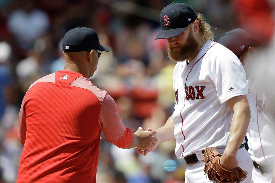 Boston Red Sox's Andrew Cashner, right, hands the ball to manager Alex Cora, left, as he is retired from a baseball game in the second inning against the Los Angeles Angels at Fenway Park, Sunday, Aug. 11, 2019, in Boston. (AP Photo/Steven Senne) Photo: Steven Senne / Copyright 2019 The Associated Press. All rights reserved