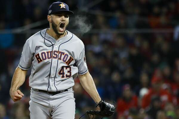 Houston Astros relief pitcher Lance McCullers Jr. (43) reacts after striking out Boston Red Sox J.D. Martinez to end the eighth inning of Game 1 of the American League Championship Series at Fenway Park on Saturday, Oct. 13, 2018, in Boston.