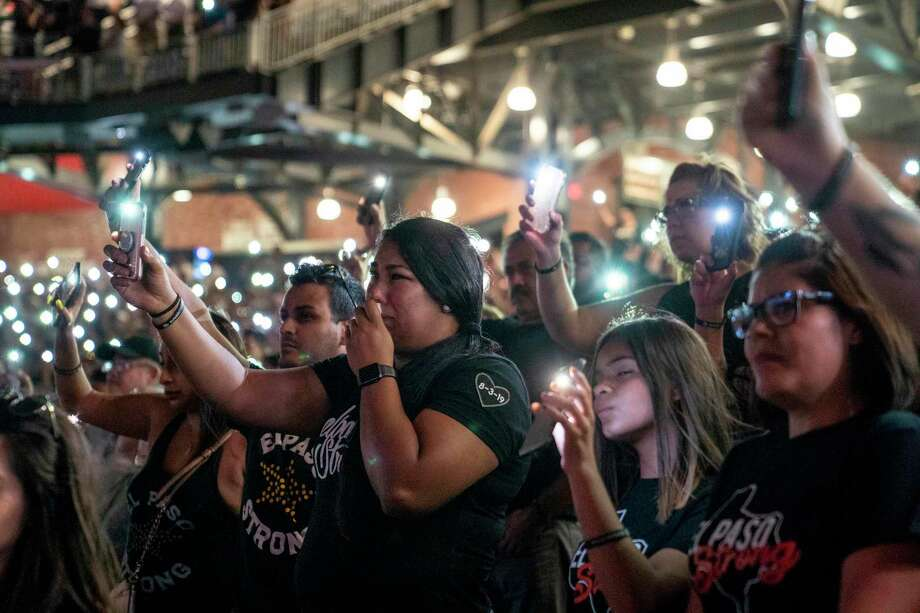 Attendees hold up the flashlights on their phones during a community memorial service for the 22 victims of the mass shooting at Southwest University Park in El Paso, Texas on August 14, 2019. - The grieving US community of El Paso came together Wednesday night, standing up to the hatred that took the lives of 22 people, many of them Hispanic, in a mass shooting. (Photo by Paul Ratje / AFP)PAUL RATJE/AFP/Getty Images Photo: PAUL RATJE, Contributor / AFP/Getty Images / AFP or licensors