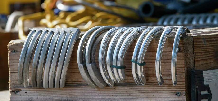 Racing plates otherwise known as horse shoes are meticulously lined up for placement on the hooves of race horses by a farrier Thursday  Aug. 15, 2019 at the Saratoga Race Course in Saratoga Springs, N.Y. Photo Special to the Times Union by Skip Dickstein