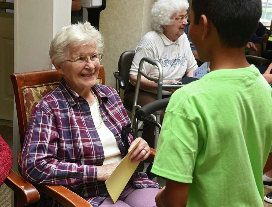 Resident Ilse Kurth, 89, receives a hand made card from Aarav Sudhaher, 10, of Watervliet after the Music Studio students performed to residents at the Atria Crossgate on Thursday Aug. 15, 2019 in Albany N.Y. This summer program titled, Catch a Rising Star, introduces children to musical theater singing and dancing. (Lori Van Buren/Times Union) Photo: Lori Van Buren / 20047658A