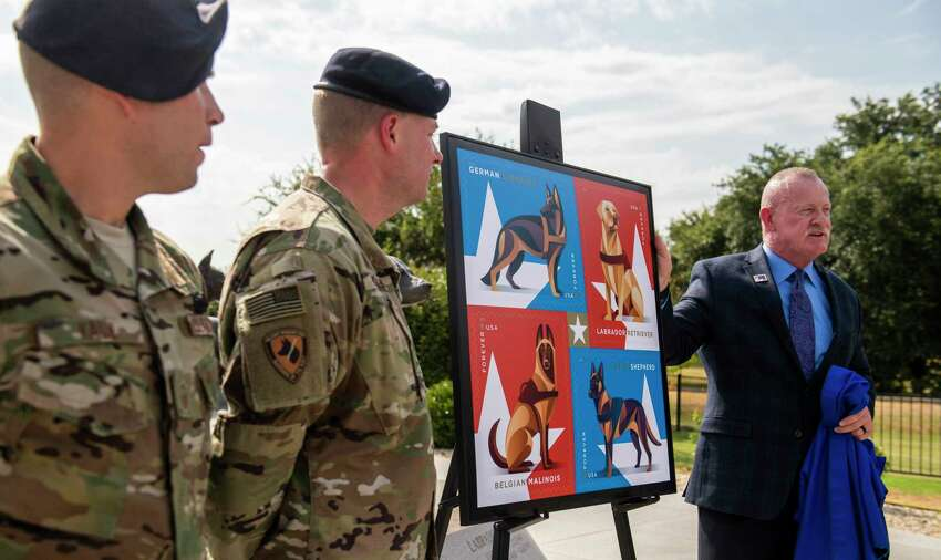 As the U.S. Postal Service unveiled a stamp honoring military working dogs, a group of handlers such as the 802nd SFS Joint Base San Antonio-Lackland's Staff Sargents Sarah Banks , left, and Brittney Turco train six year old Tarzan at Joint Base San Antonio-Lackland on Thursday, August 15th, 2019.