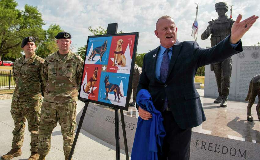 As the U.S. Postal Service unveiled a stamp honoring military working dogs, a group of handlers such as the 802nd SFS Joint Base San Antonio-Lackland's Staff Sargents Sarah Banks, top left, and Brittney Turco train six year old Tarzan at Joint Base San Antonio-Lackland on Thursday, August 15th, 2019.
