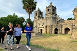 People leave after experiencing the annual double solar illumination seen at Mission Concepcion, 807 Misson Road, at precisely 6:30 p.m. on Thursday, Aug. 15, 2019. This once-a-year event has sunlight shining through the window above the front door to the center of the cross-shaped church. At exactly the same moment, sunlight coming through a dome window shines onto the face of the Virgin Mary painting above the main altar. Several historic Spanish missions have solar illuminations but a double one is rare, officials say.