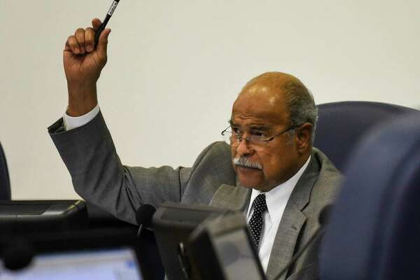 BISD Board President A.B. Bernard raises his hand during a vote during BISD's board meeting at the Administration Building Thursday evening. Photo taken on Thursday, 06/20/19. Ryan Welch/The Enterprise