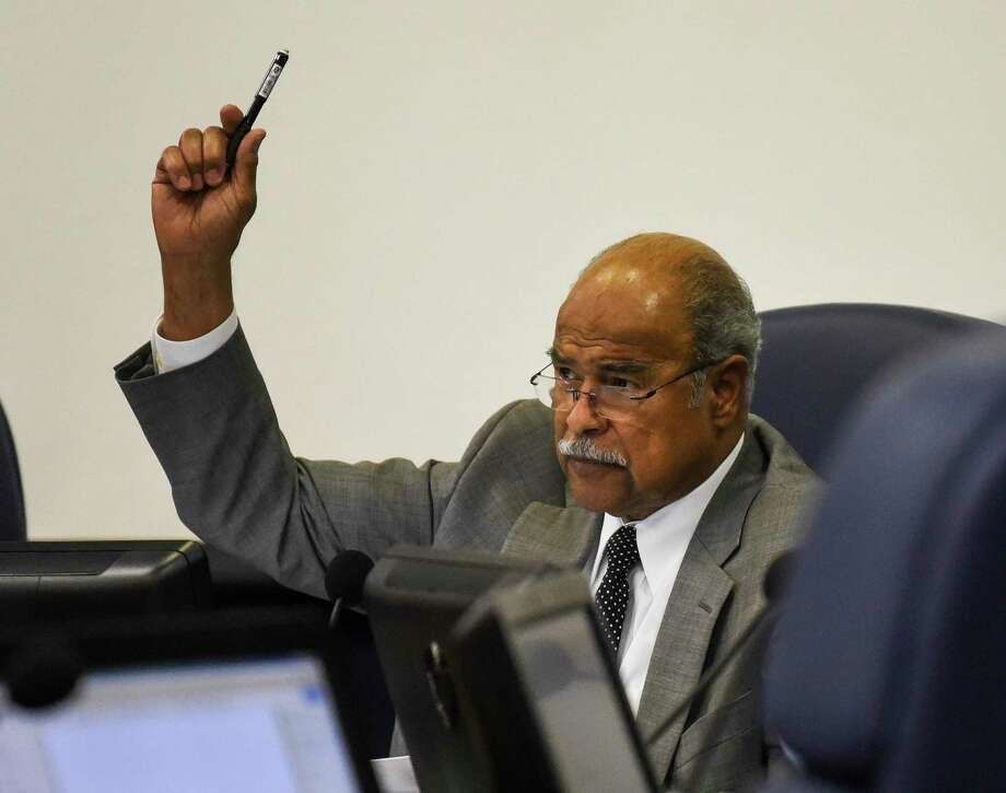 BISD Board President A.B. Bernard raises his hand during a vote during BISD's board meeting at the Administration Building Thursday evening. Photo taken on Thursday, 06/20/19. Ryan Welch/The Enterprise Photo: Ryan Welch / Ryan Welch/The Enterprise / © 2019 Beaumont Enterprise