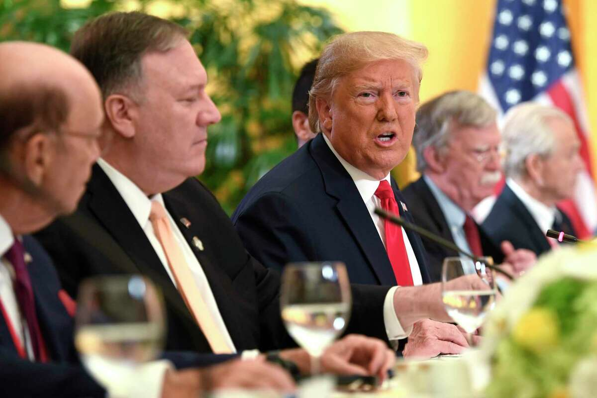 President Donald Trump, center, sitting with, from left, Commerce Secretary Wilbur Ross, Secretary of State Mike Pompeo, National security adviser John Bolton, and White House trade adviser Peter Navarro, speaks as he meets with Saudi Arabia's Crown Prince Mohammed bin Salman during a working breakfast on the sidelines of the G-20 summit in Osaka, Japan, in Osaka, Japan, Saturday, June 29, 2019.