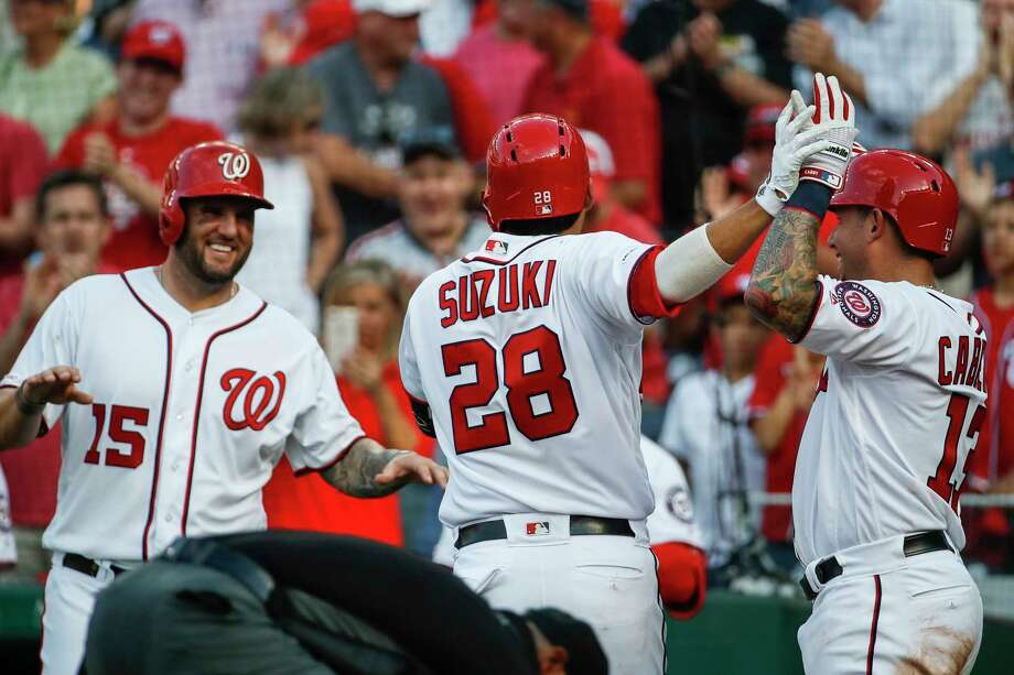 Washington Nationals catcher Kurt Suzuki celebrates his three-run homer with Matt Adams (15) and Asdrubal Cabrera during the fifth inning of a baseball game against the Cincinnati Reds at Nationals Park, Wednesday, Aug. 14, 2019, in Washington. (AP Photo/Alex Brandon) Photo: Alex Brandon / Copyright 2019 The Associated Press. All rights reserved.