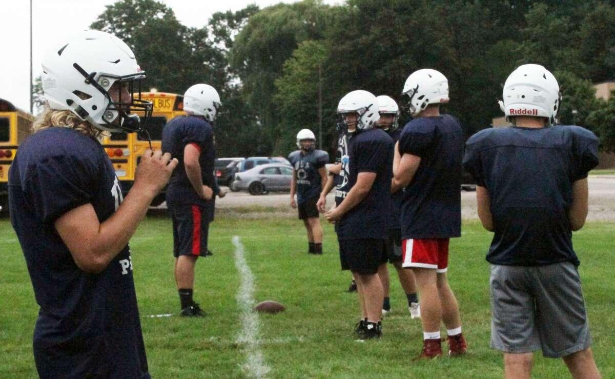 The Unionville-Sebewaing Patriots run drills Thursday in Sebewaing.