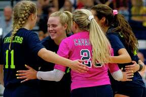 College Park setter Annie Cooke (17) reacts with teammates after scoring a point in the first set of a match during the Kingwood Invitational.